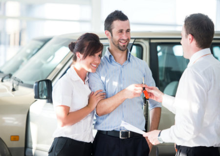 Couple who have negotiated a great price on a used car